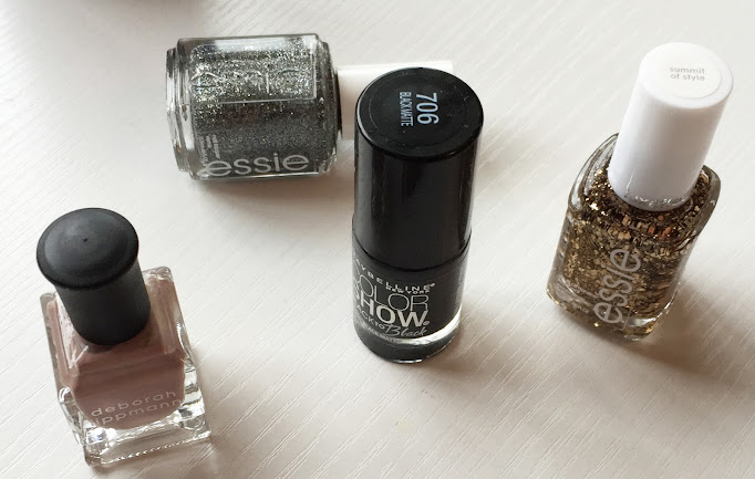 Glitter, pastels and stylish blacks for winter nails.