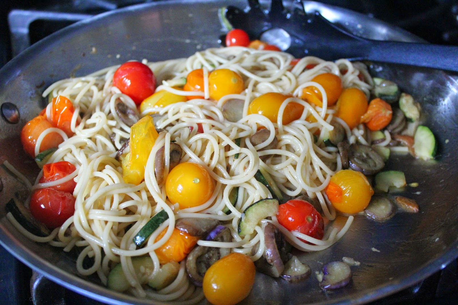 Pasta with zucchini, fairytale eggplant, and tomatoes