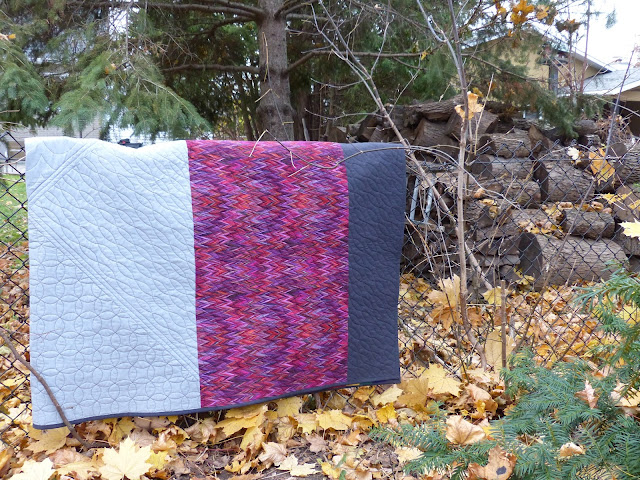 Another angle of folded back of Carsick quilt.