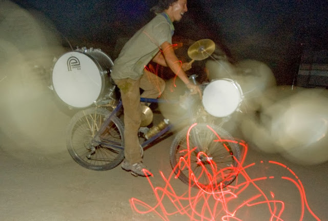 an art bike that plays drums and blinks