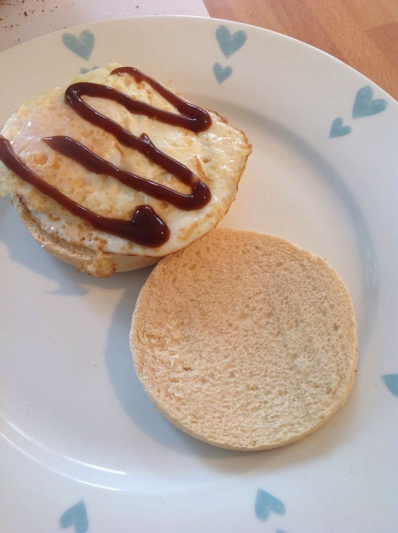 fried egg in an english muffin with brown sauce