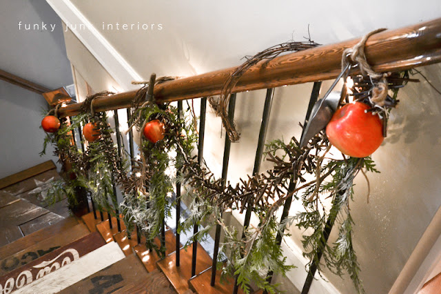 Christmas stairway garlands via Funky Junk Interiors - home tour 2012