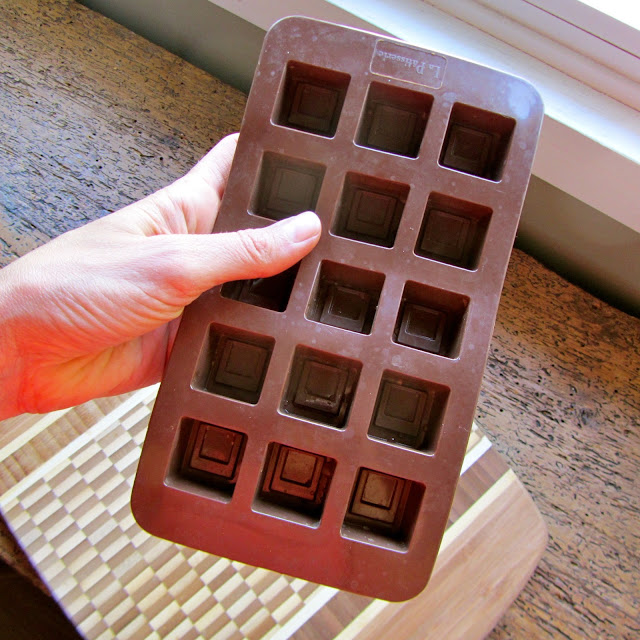brown silicone chocolate mould held in a hand