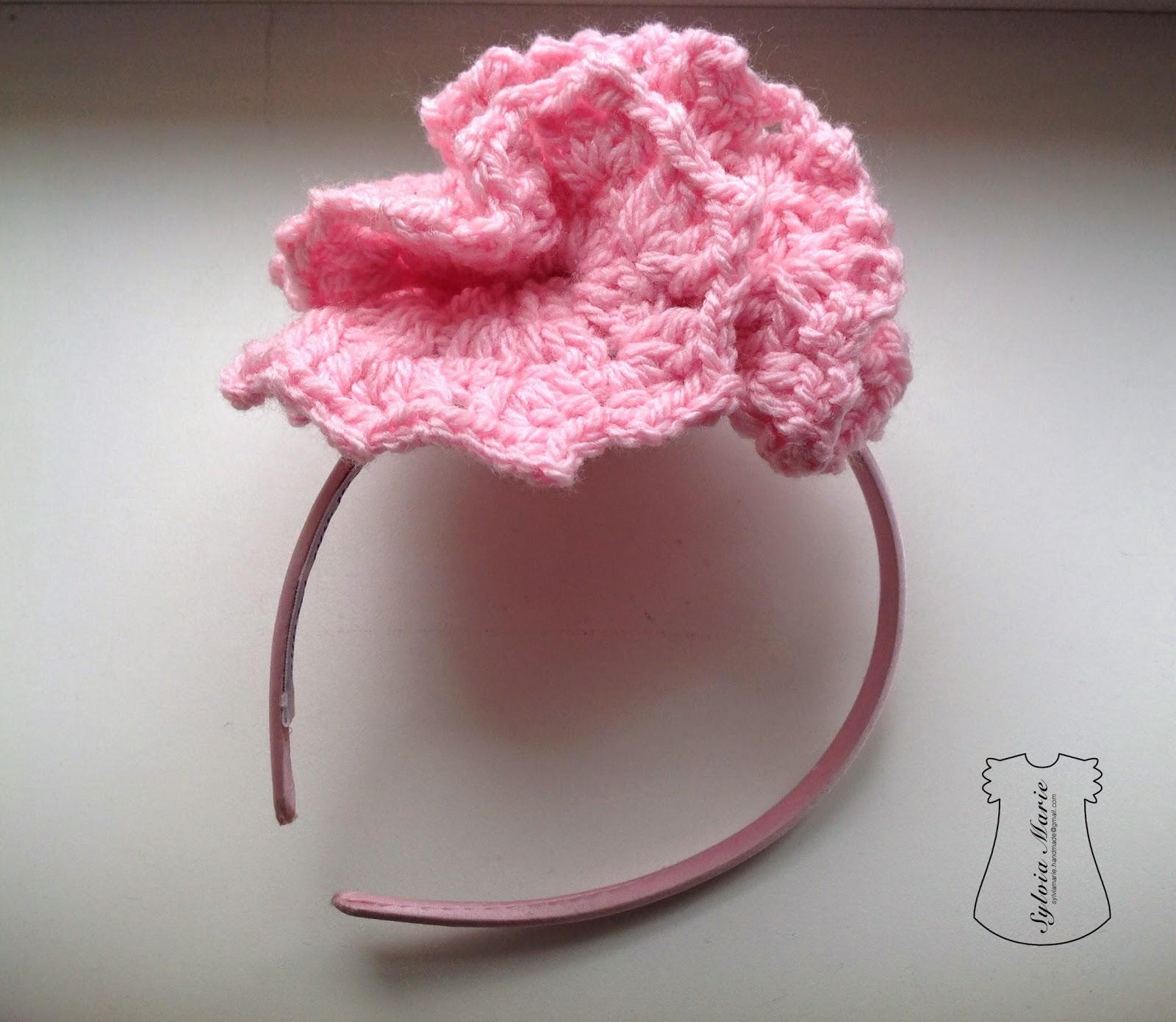 Diadema con flor rosa hecha a mano