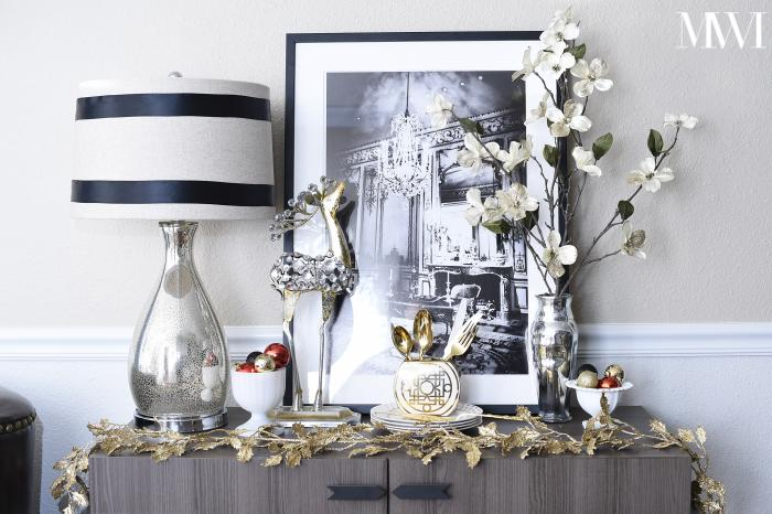 A dining room and sitting area look glam and festive for the holidays. The black, white, gold and red combo is perfection!