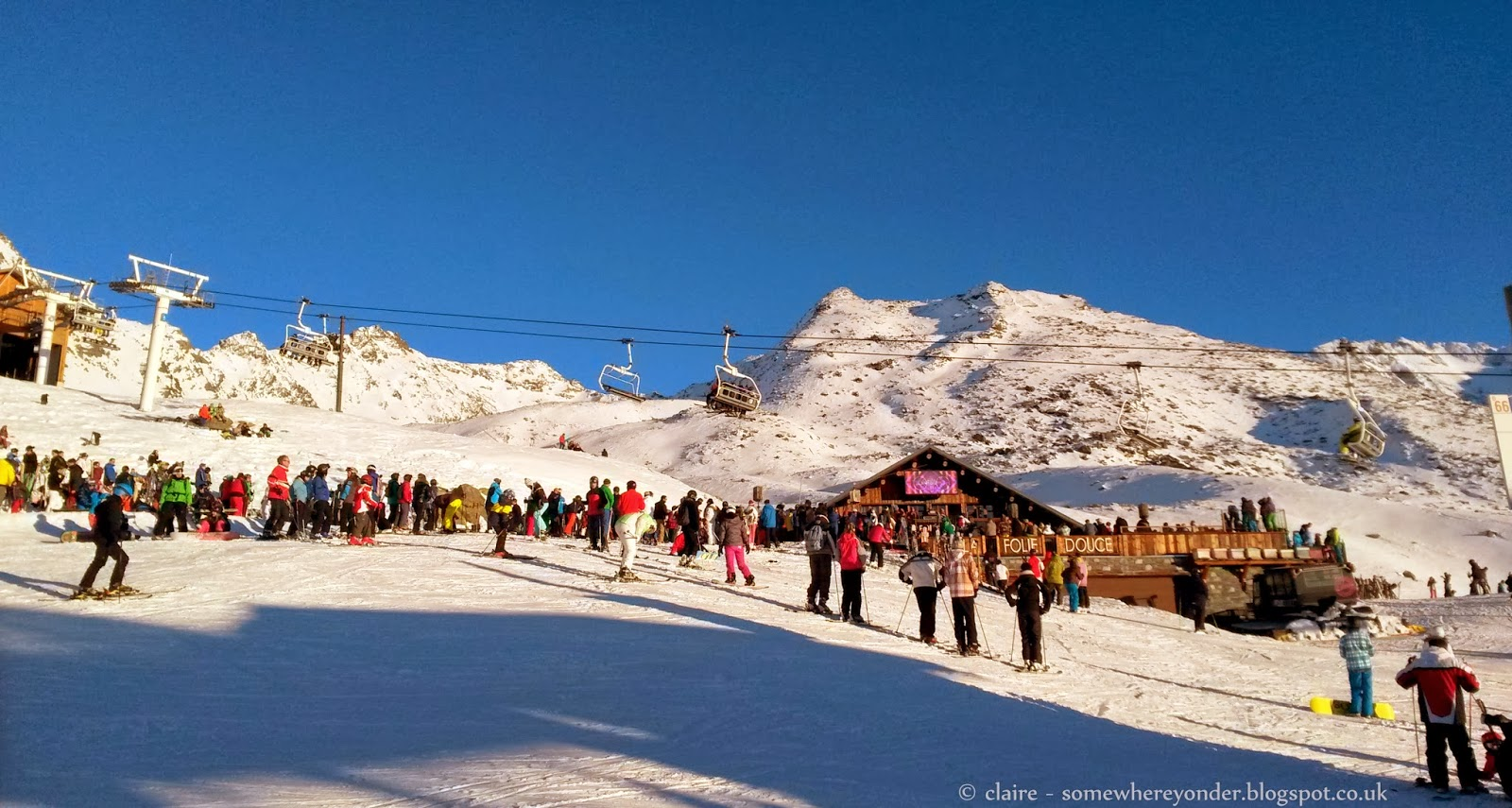 Skiers heading to La Folie Douce to party in the afternoon sun - Val Thorens, France