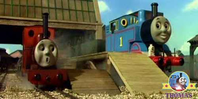 Orange red and violet Rheneas the tank engine with Sodor wharf Thomas the tank engine the blue train
