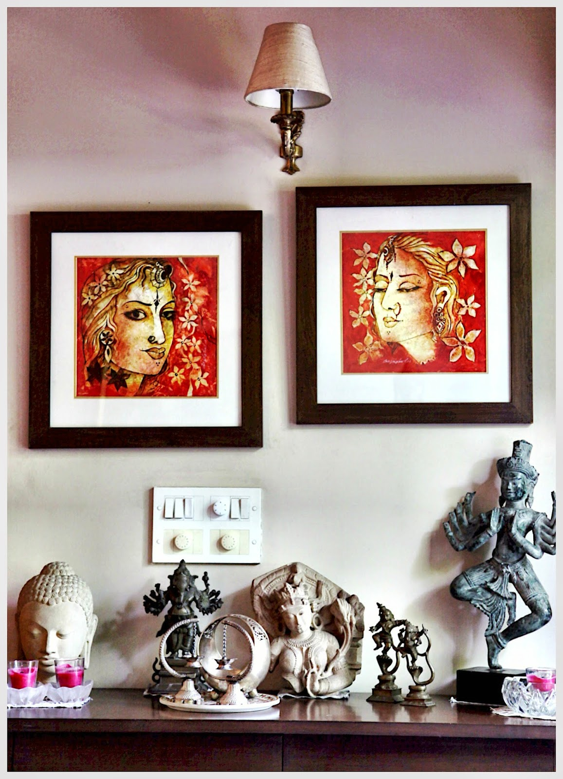 Grouping Balinese Sculptures With Traditional Indian Statues Creates An Eye Catching Display In This Corner Of The Living Room