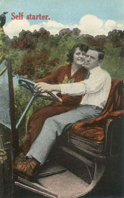 vintage postcard of cuddling couple in a car