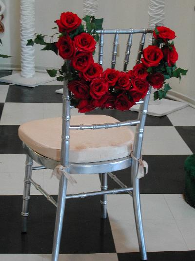 These wedding chair decorations can be attached to places of honor for the
