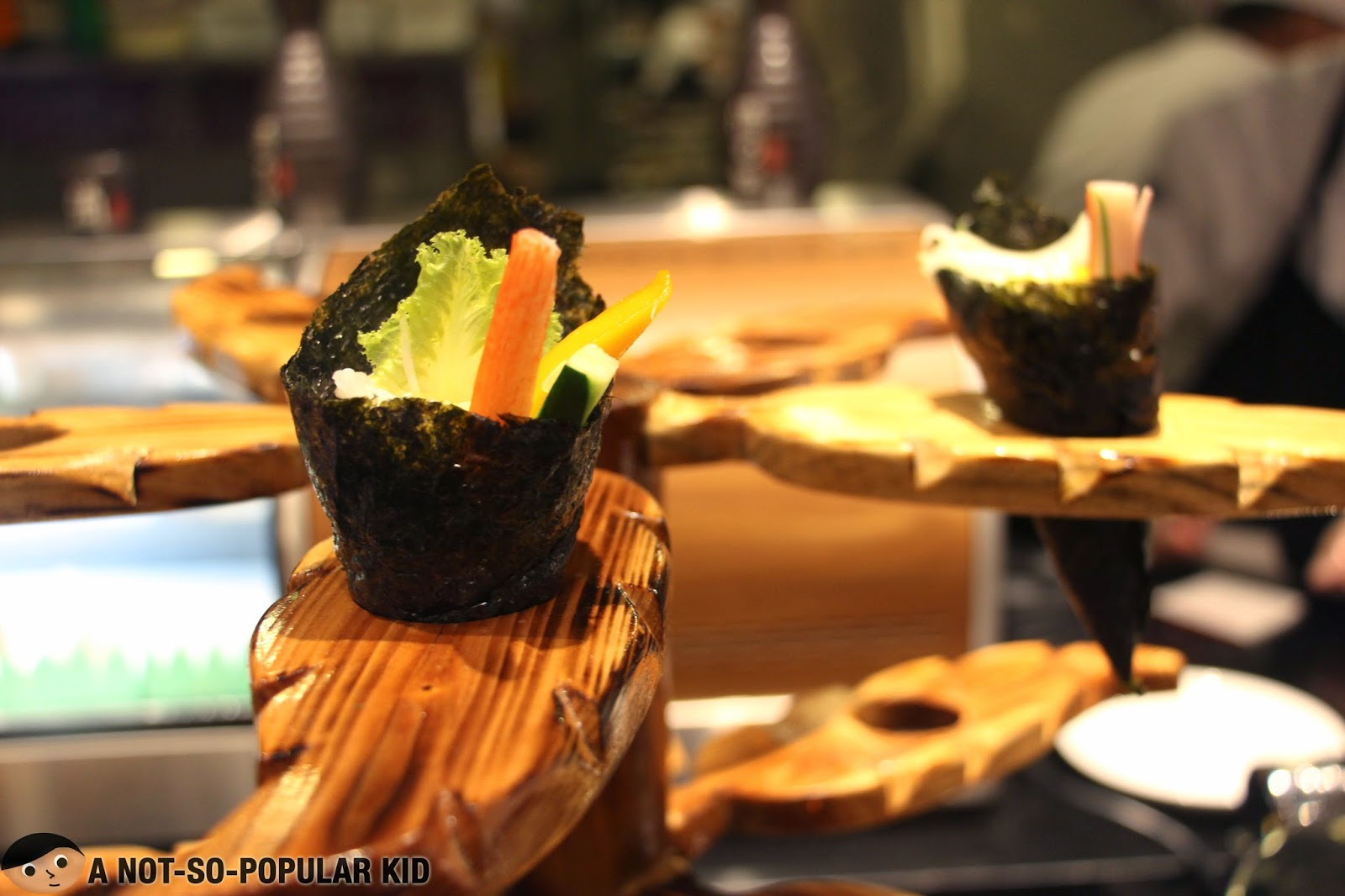Veggie, kani and mango wrapped in nori seaweed in Vikings