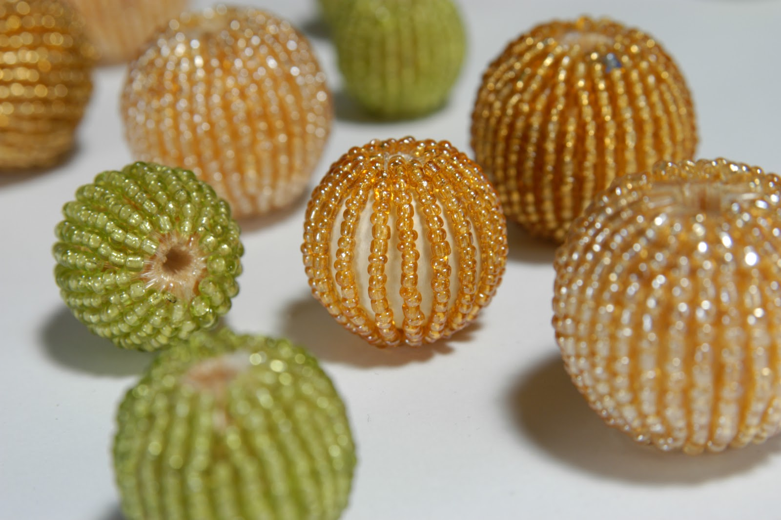beads are threaded around a larger wooden bead to create beaded beads