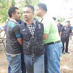ditangkap kerana menghalang tindakan kerajaan negeri terengganu merobohkan rumah rakyat di kg. paya