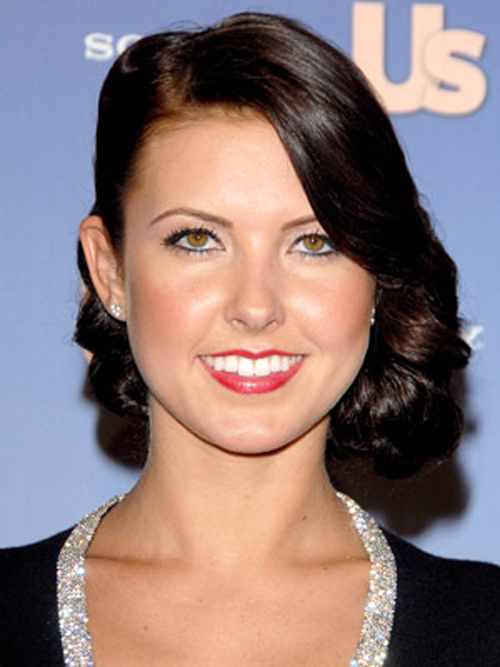 Glossy ribbons of curl are pinned up in an ultra-elegant evening hairstyle for Audrina Patridge.