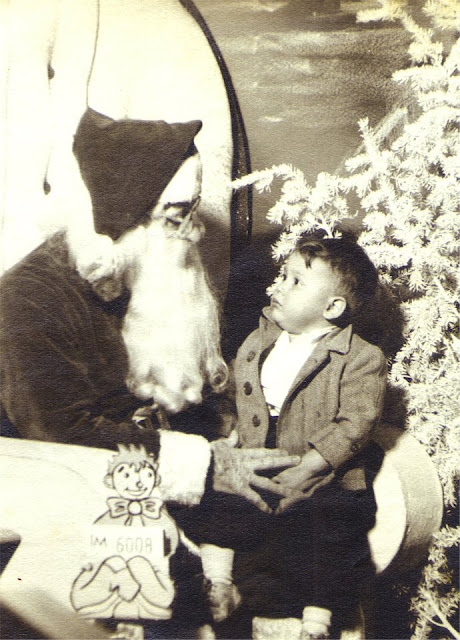 Toddler on Santa's lap (my dad is the toddler!)