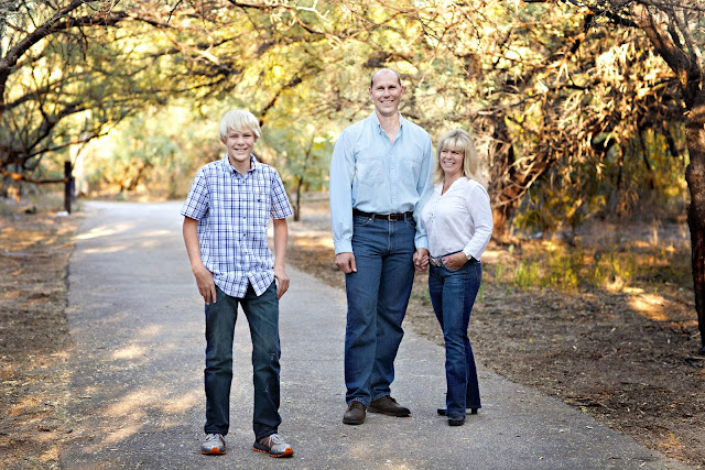 Sahuarita family look towards a Tucson photographer during family photo session