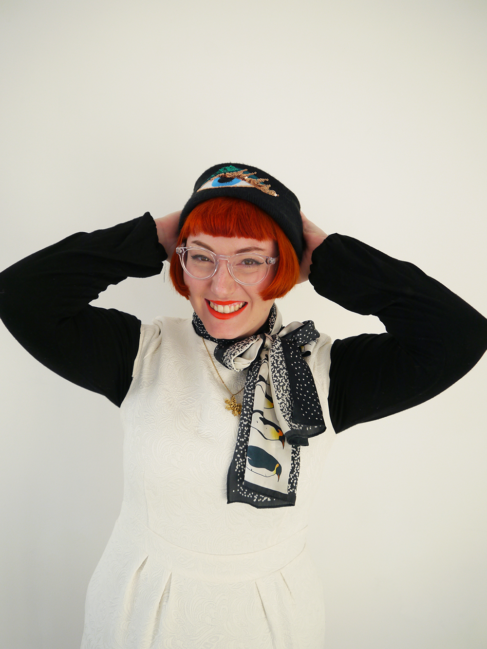 Unlikely Style Icon, Chritsmas Style Icon, Christmas style, snowman style, cute snowman costume, festive style, winter style, red headed blogger, red hair, ginger, Iolla glasses, #seewithiolla, Bershka Eye hat, sequin hat, fun winter hat, Karen Mabon, KAren Mabon scarf, Penguin scarf, Bonnie Bling, snowflake necklace, Bonnie Bling acrylic jewellery, Bonnie Bling necklace, winter necklace, gold snowflake necklace, white dress, short white dress, layering, layered style, Ted & Muffy, ted and muffy, ted and muffy boots, Victorian style ankle boots, witchy style boots, black ankle boots, Scottish blogger