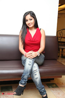 Madhavi Latha  Pictures in Red Sleeveless Top and Jeans at Muse Art Gallery  0003.jpg