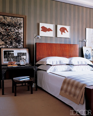 wood headboard, masculine bedroom, tailored bedding, warm interiors, art in the bedroom