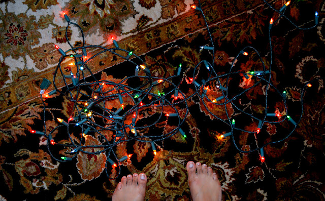 christmas lights with toes and feet of Fashion Blogger Anais Alexandre of Down to Stars
