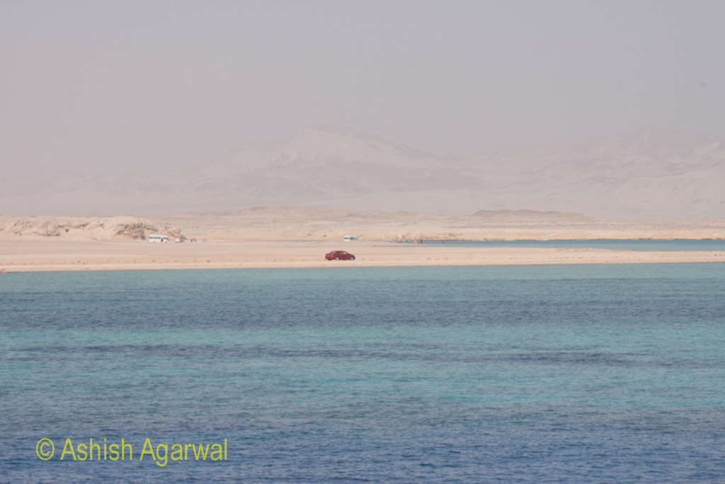 Vehicles on the shore near the coral reefs off Sharm el Sheikh in Egypt
