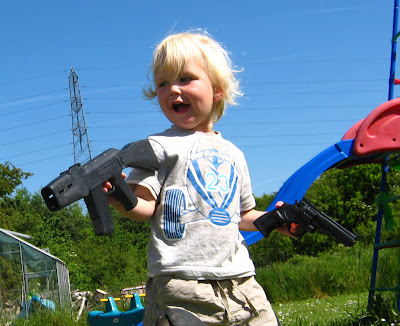 boy with toy guns