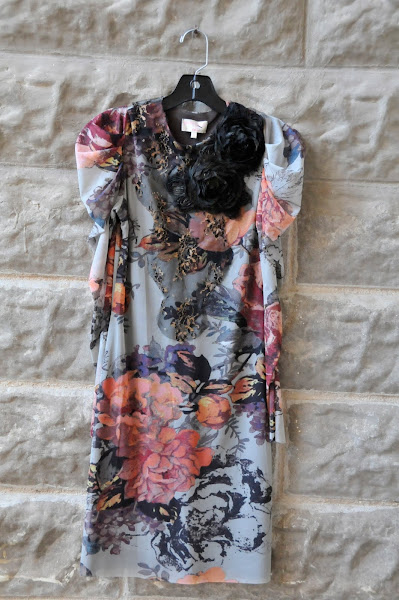 Tunic floral top with lace applique and roses.  $174