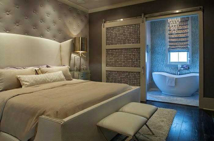 grey upholstered wall panels go very well with a white bed.