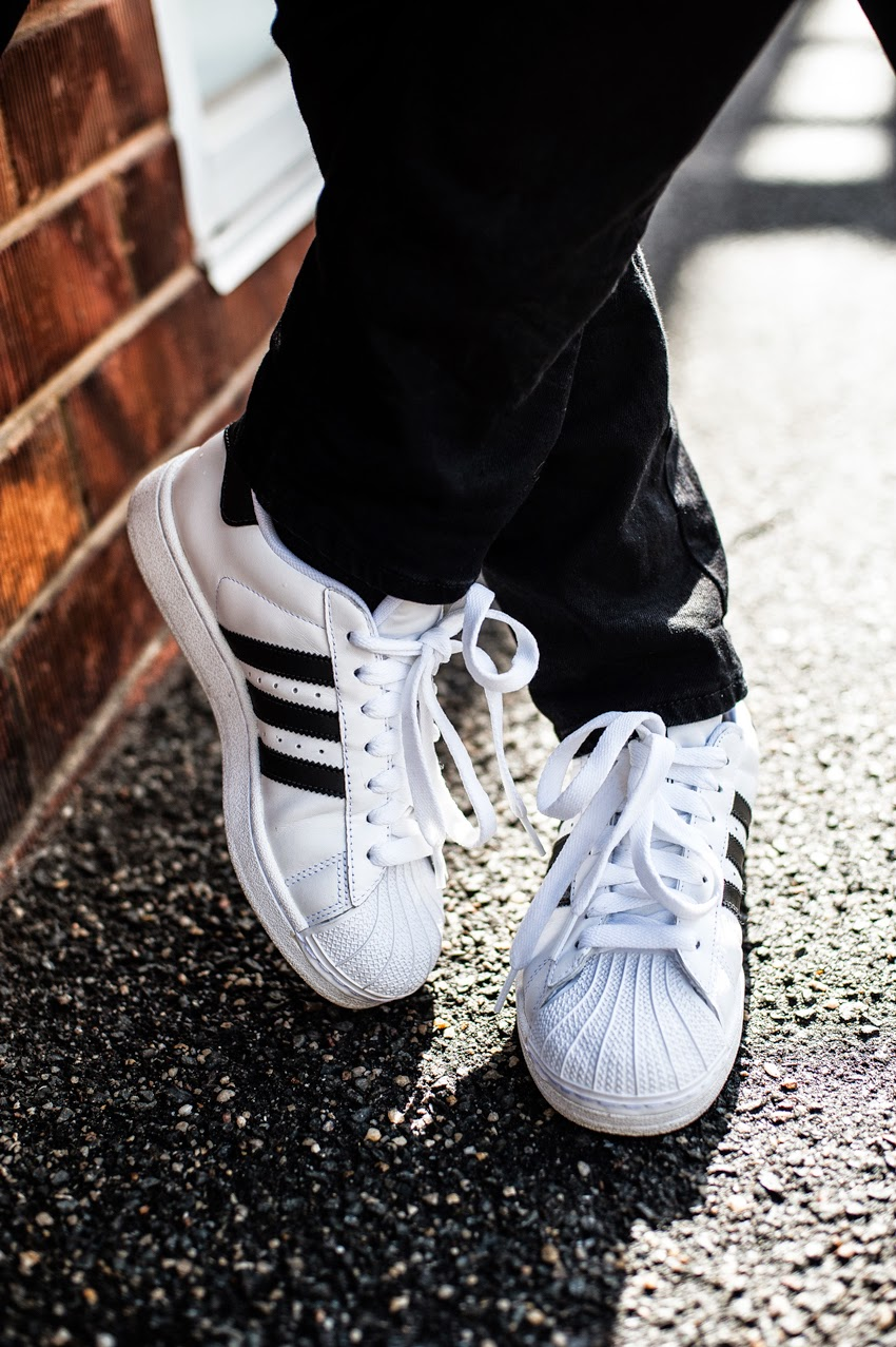 Close up of my Adidas Superstar black and white sneakers shooting into the sun