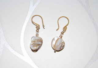 http://www.etsy.com/listing/68623026/mother-of-pearl-nugget-shell-earrings