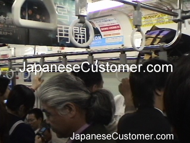 Japanese Customers commuting Copyright Peter Hanami 2014