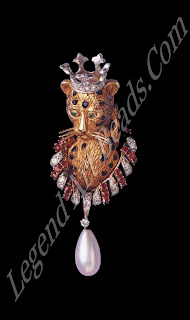A leopard brooch in gold, platinum, rubies, diamonds and cabochon emeralds, 1957.