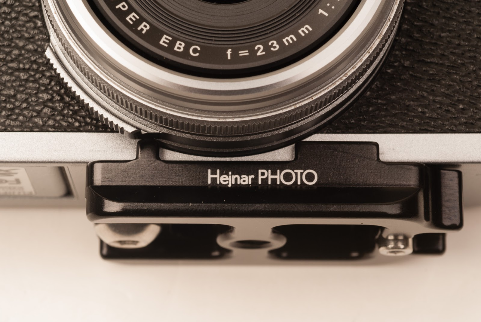 Hejnar PHOTO D027 QR plate fitting below Fuji X100 lens