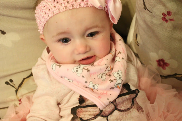 baby wearing pink Olaf Frozen bib