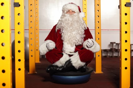 Santa doing yoga