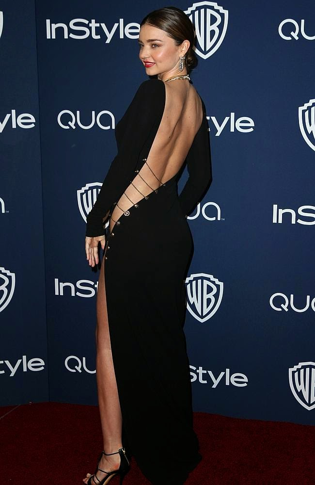 This black dress is perfect once with Miranda Kerr, because once the ideal body shape of Miranda Kerr also this black dress is perfect with Miranda Kerr face shape once the sweet as sugar.