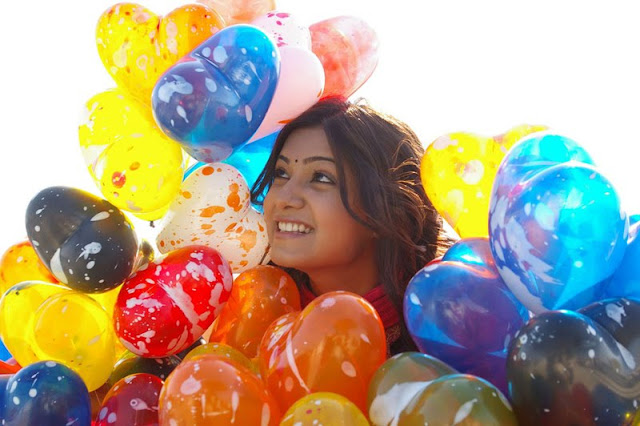samantha with colorful balloons