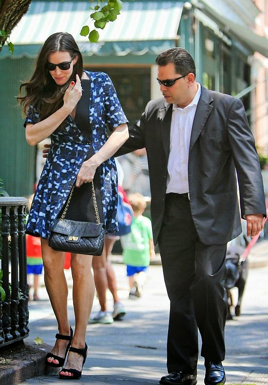 There's a reason why Liv Tyler always makes the best dressed list, she has a fantastic eye for a killer frock. Just take a look at here as the 37-year-old showed off her impressive charm in a blue dark mini dress while walking by herself at the street in New York on Wednesday, July 2, 2014.