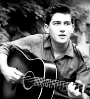 Phil Ochs with guitar