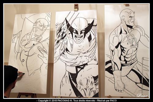 Paco illustrateur graphiste repassant le dessins de Iron Fist sur toile acrylique