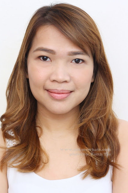 a photo of a girl using  Celeteque Cheek Color Stick in Peach