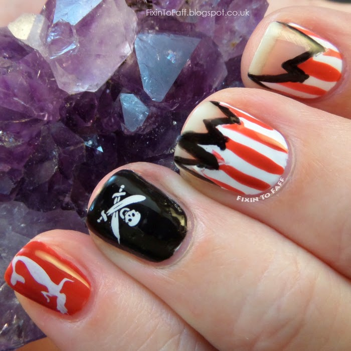Freestyle pirate-themed nail art for the Avast Ye Bilge Rats pirate nail art challenge, day 5.