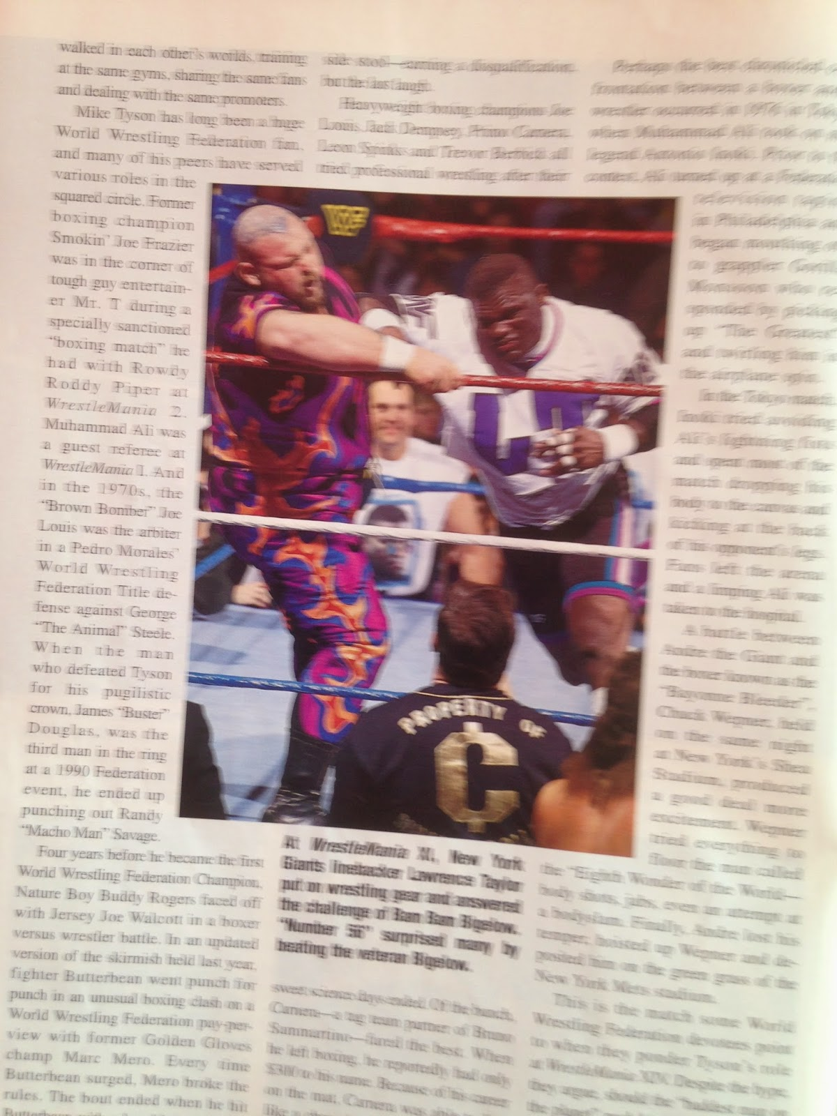 WWE - WWF Raw Magazine - April 1998 -   Lawrence Taylor battles Bam Bam Bigelow