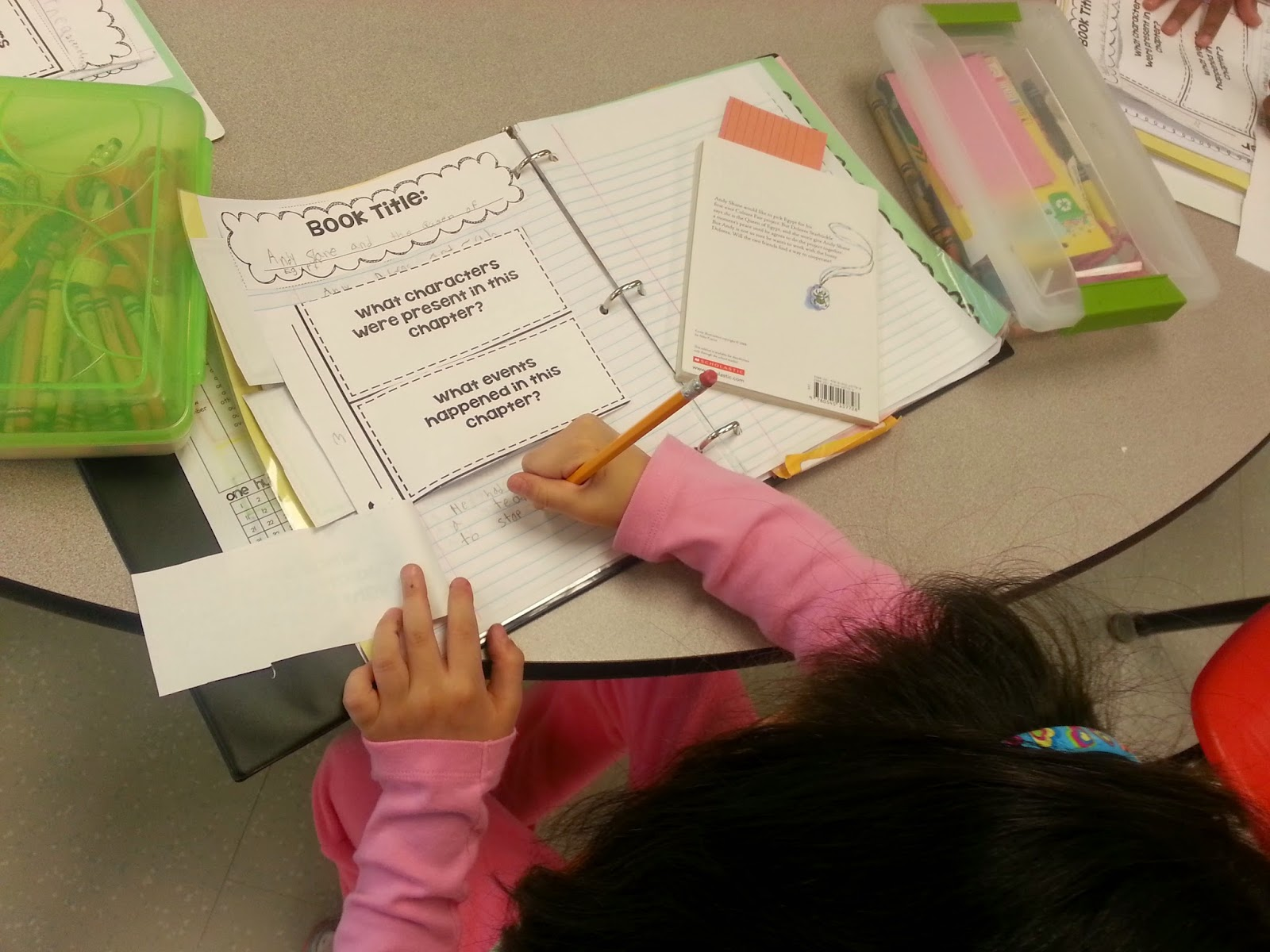 Student writing in interactive notebook