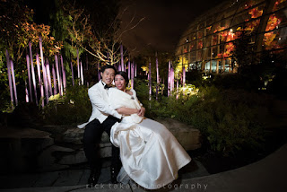 The bride and groom cuddle in the Chihuly Garden - Kent Buttars, Seattle Wedding Officiant