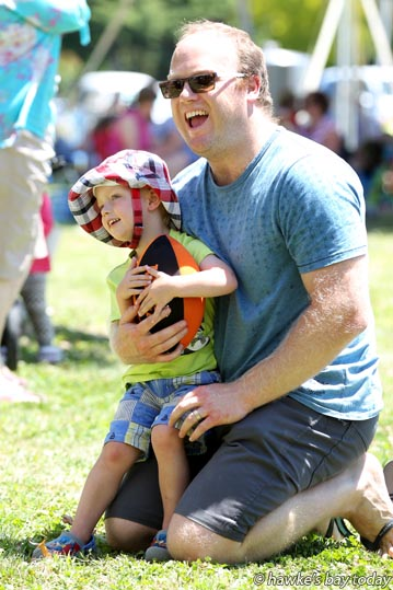 Henry Lincoln, 3, watching the show with his father Chris Lincoln, Napier, at Another Day in Taradise, a concert day at Moana Park Winery, Puketapu, Napier. photograph