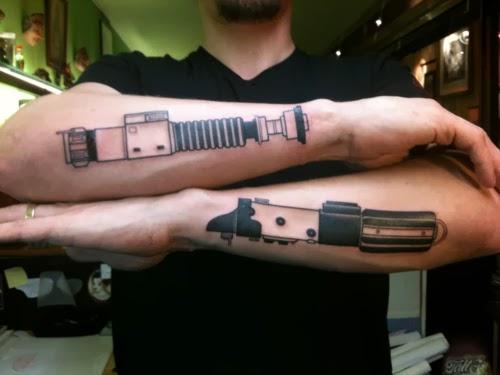 light saber arm tattoo