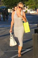 Pamela Anderson fixing her bra