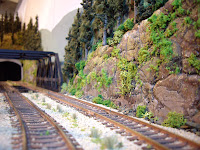 Ballasted track and scenery on background section