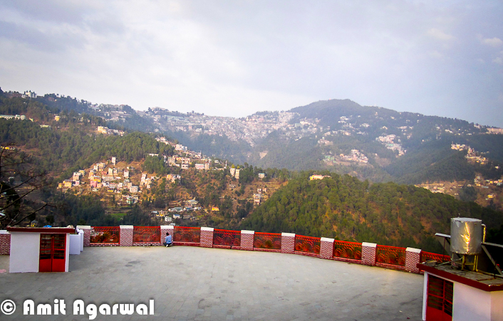 Sankat Mochan Temple is one of the popular Temples in Shimla Town. It's not exactly in Shimla, but quite near to it. Let's have a quick Photo Journey from Sankat Mochan Temple by Amit Agarwal.. Sankat Mochan Temple is actually located near to Tara-Devi which comes on the way to Kalka from Shimla Town. It's approximately 10 kilometers from Shimla Town. Place is surrounded by green mountains all around. Temple is adjacent to the National Highway - 22. The temple is a place where one can actually meditate and enjoy the calm and peaceful surroundings.The very first photograph above shows a temple on left, which is located just after main entry into the Sankat Mochan Temple. This temple is created in South Indian Style.Around 1950, a Baba came to this beautiful place and discovered the perfect spot for meditation and soulful introspection. After staying here for 10 days, he desired that a temple dedicated to Lord Hanuman should be built here. Baba's faithful devotees included the governor of Himachal Pradesh, who along with Bhagvan Sahai took up the task of building the temple and fulfilling their Guru's wish.Sankat Mochan temple has many facilities for people and also includes a three-storey building that is used for many purposes. Every Sunday, the huge hall in the building is used for distributing Prasad, also known as Langar. Langar at Sankat Mochan is quite different and very well managed.  One portion of the building is used to conduct marriage ceremonies and is rented out to people who want to conduct marriages. The temple charges a very nominal fee for this. Apart from marriages, there are many other sacred rituals and ceremonies that can be conducted over here. Priests and the maintenance staff, who work here day and night, use the rest of the building as a residential complex. The temple also has an Ayurvedic clinic...Here is a photograph showing interiors of main Sankat Mochan Temple.There are few small Temples in the campus which are dedicated to different go